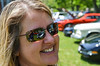 This is a mom I met at the car show.  The kids with her were going around shooting pictures of the cars with their phones.  They saw me shooting the hubcaps and I showed them why.  Well, they thought that was very cool so they went around doing it as well.  So I showed the mom how I could shoot the cars from the reflections on her glasses.